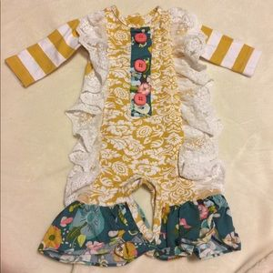 Infant girls One piece ruffle outfit.
